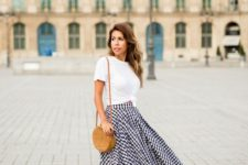 With white t-shirt, round straw bag and heels