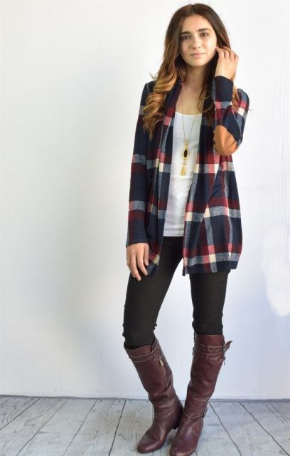 With white top, black leggings and brown high boots