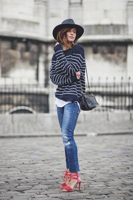 With wide brim hat, red high heels, jeans and black bag