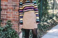 With wrap skirt, black tights and heels