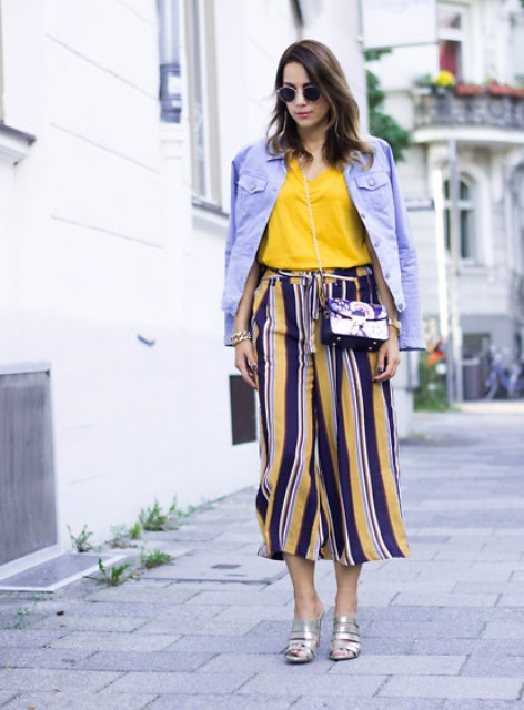 With yellow shirt, denim jacket, striped culottes and chain strap bag