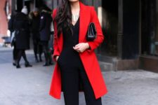 02 a black jumpsuit paired with a red coat, black heels and a clutch for work