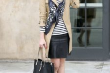 02 a black leather skirt, a striped top, a tan trench with a black edge and a black bag