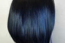 02 a black short bob with dark blue highlights that look unobtrusive and calming