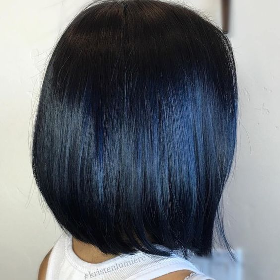 a black short bob with dark blue highlights that look unobtrusive and calming