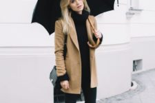 02 a black sweater, black leather pants, black rubber boots, a short camel coat for rainy days