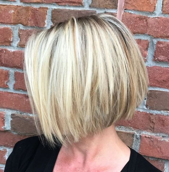 a choppy straight bob haircut with a dark root gives your hair a dimension at once