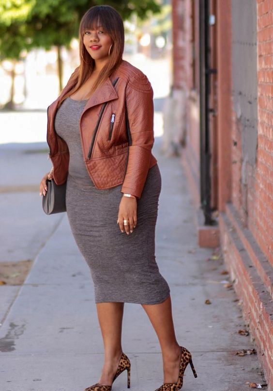 a grey bodycon midi dress, an amber leather jacket, leopard printed shoes and a grey bag