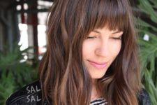 02 a layered brunette A-line lob with fringe bangs and highlights is a great cut for someone seeking versatility