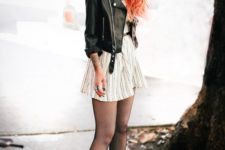 02 a white striped dress with a belt, a black cropped leather jacket, black boots and tights