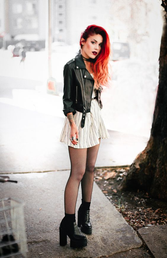a white striped dress with a belt, a black cropped leather jacket, black boots and tights