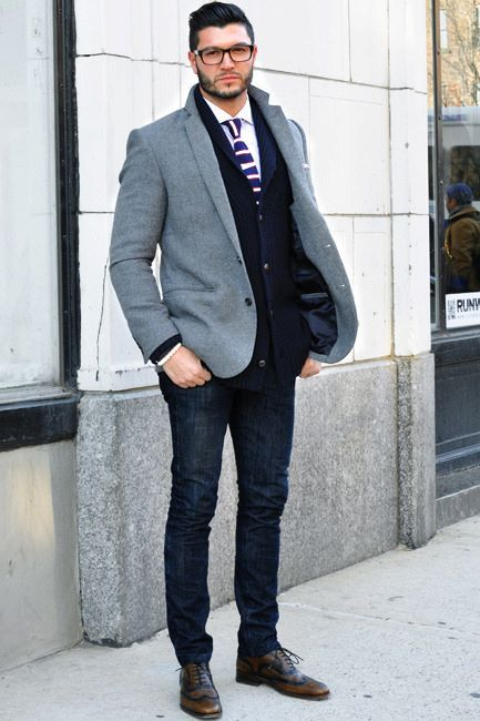 navy jeans, a white shirt, a striped tie, a navy blazer, a grey coat and brown shoes