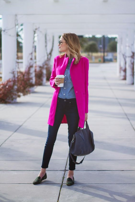 a blue shirt, navy skinnies, green flats, a fuchsia coat and a bag