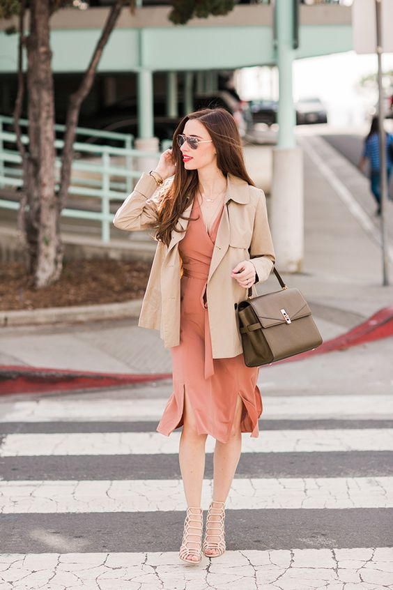 a coral wrap dress with slits, a tan short trench, metallic shoes and a brown bag for the fall