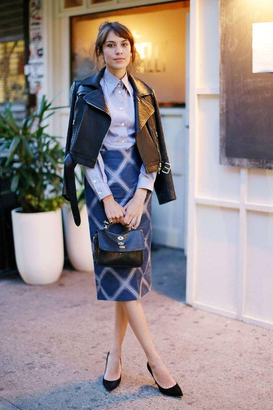 a lavender shirt, a printed midi skirt, a black cropped jacket, black shoes and a bag