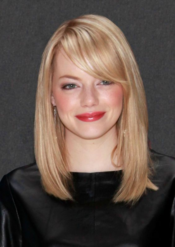 a layered long bob with side bangs is a sophisticated and timeless idea for many girls