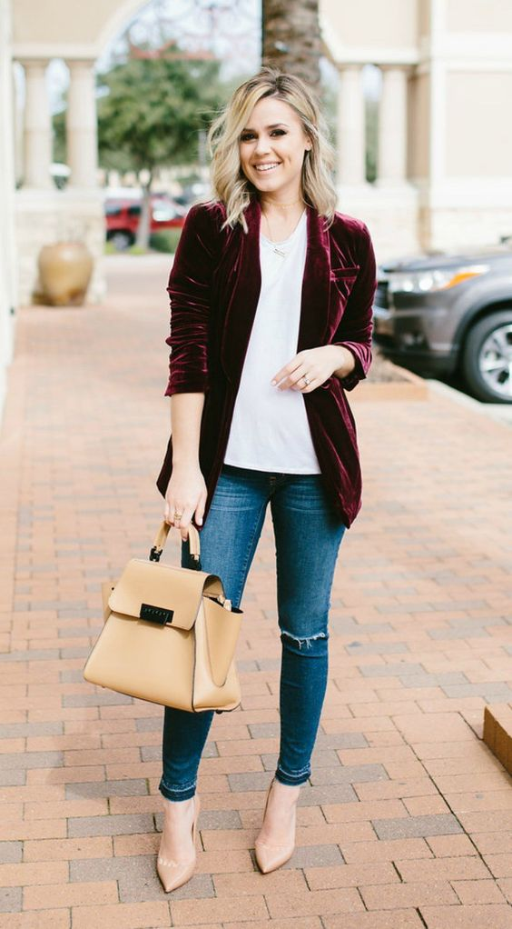 a plum-colored velvet blazer, a white tee, blue denim, nude shoes and a nude bag