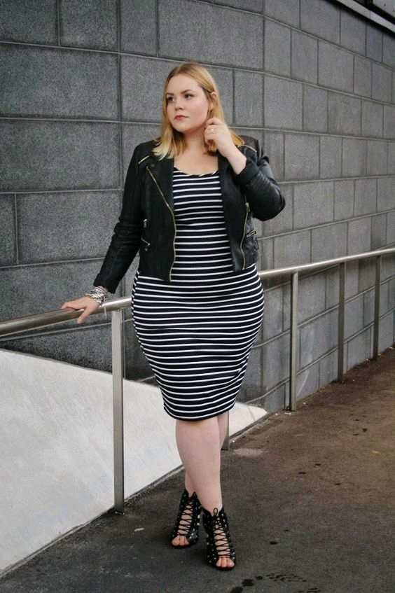 a striped black and white midi dress, lace up shoes and a black leather jacket for a date