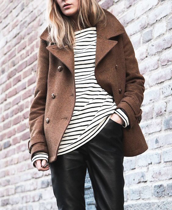 black leather pants, a striped top and a short brown coat to feel comfy