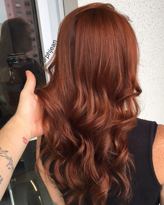 chic long auburn hair with waves is all you need to be bold this fall