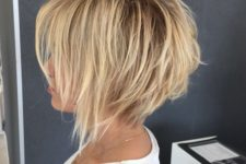 04 a cute shaggy inverted bob haircut with bangs in blonde for an edgy modern feel