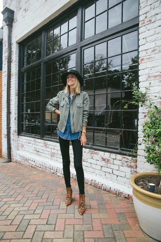 a fall look with black skinnies, a blue chambray shirt, an olive green jacket, leopard booties and a black hat
