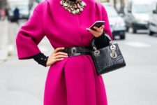 04 a fuchsia coat and a statement necklace over it, a belt and a bag for a catchy girlish look
