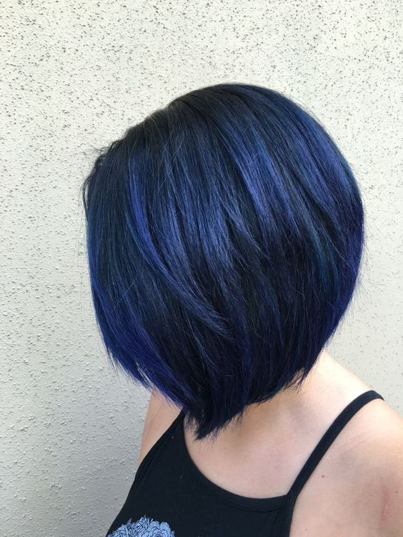 a short layered blue black bob with balayage is a trendy coloring idea for fall or winter