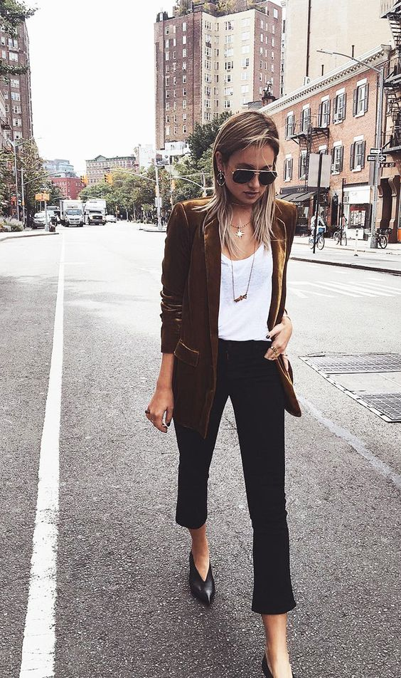black cropped jeans, a white top, a rust velvet blazer and black booties with pointed toes