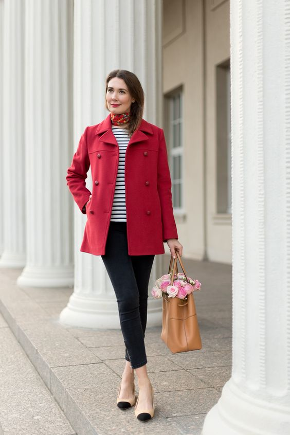 two tone flats, black cropped jeans, a striped top, a red short coat and a camel bag