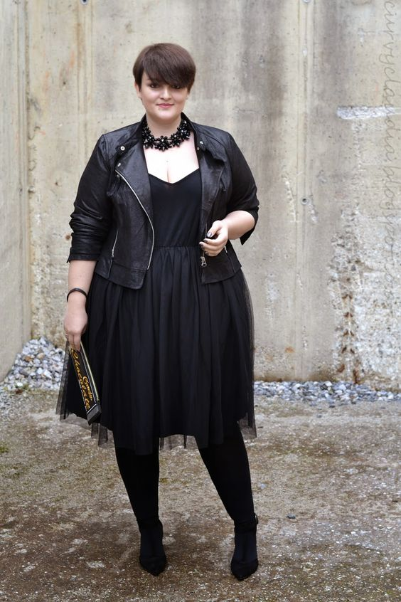 a chic party look with a black dres,s tights, velvet shoes, a statement necklace and a black leather jacket