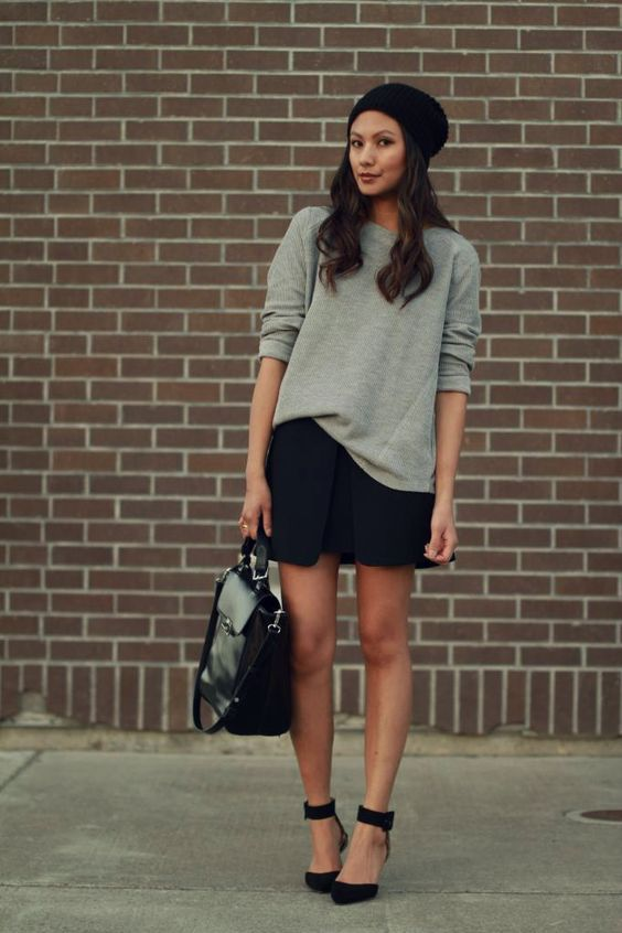 a grey sweatshirt, a black modern mini, black heels and a bag for a catchy modern look