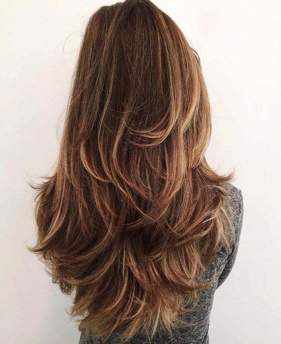 a long layered haircut with feathered ends is a gorgeous idea to show off your hair