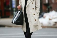 05 black skinnies, a black top, black Converse and a neutral short trench
