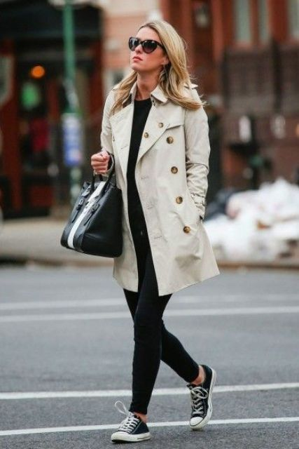 black skinnies, a black top, black Converse and a neutral short trench