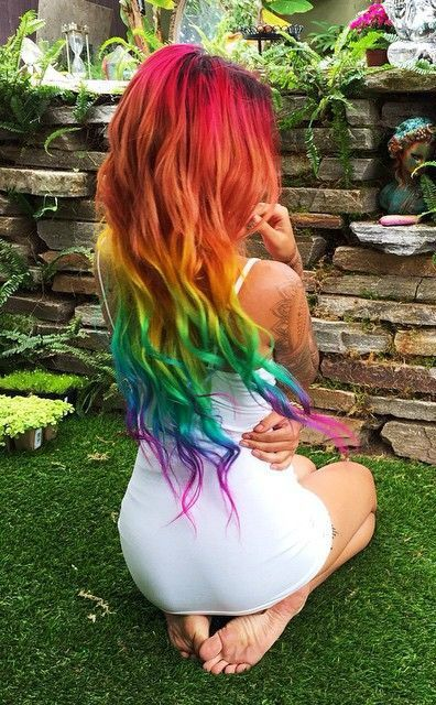 long wavy hair dyed in rainbow colors is a great bright idea to rock