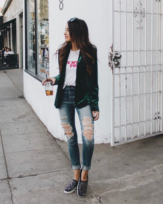 ripped skinnies, a printed tee, an emerald velvet blazer, embellished slipons