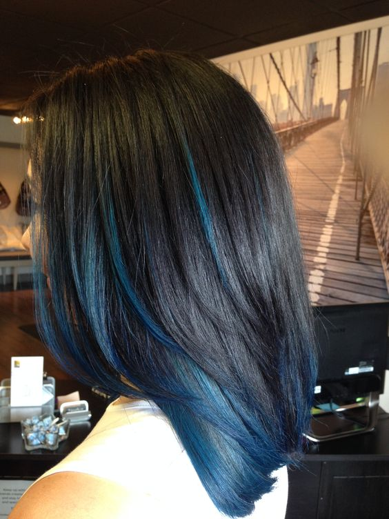 a black layered long bob with blue highlights and ends for a touch of rock