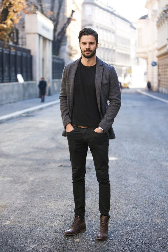 a black tee, black jeans, brown boots, a grey blazer for a casual work look