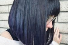 06 an angled bob with bangs is styled straight to highlight the angles