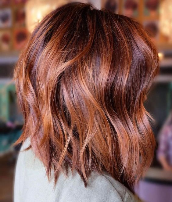 Picture Of An Auburn Long Bob With Copper Balayage And Loose