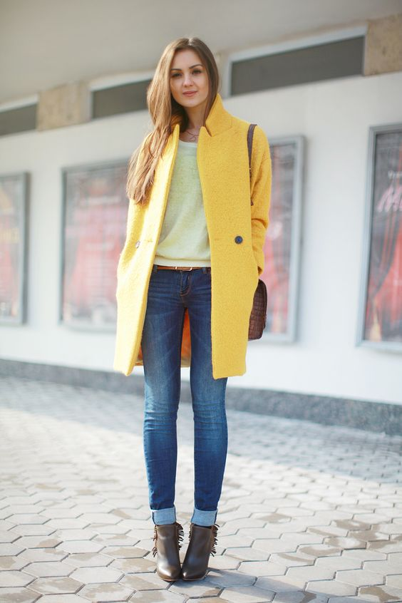 brown booties, blue skinnies, a neutral top, a bright yellow coat for the fall