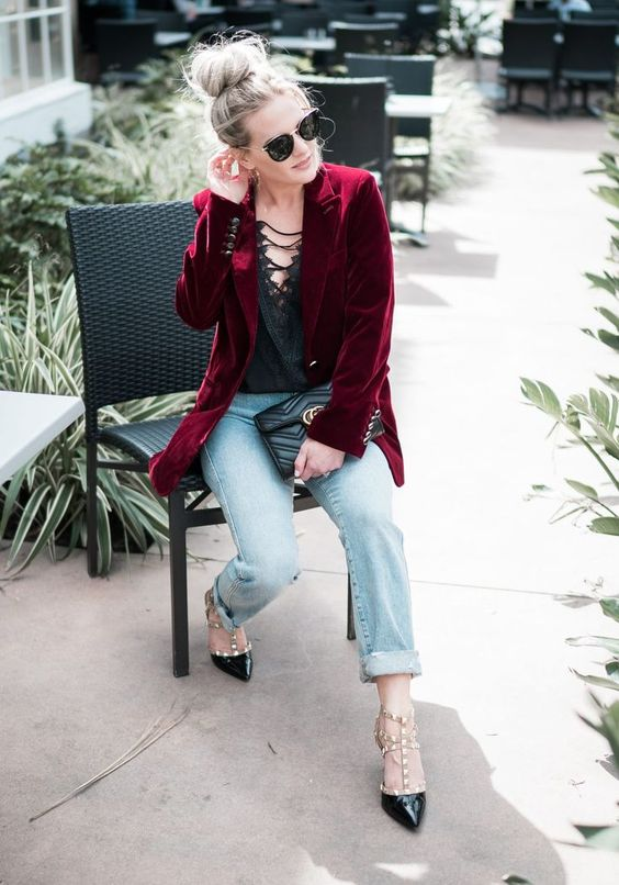 light blue boyfriends, a black lace top with straps, a burgundy velvet blazer and black studded shoes