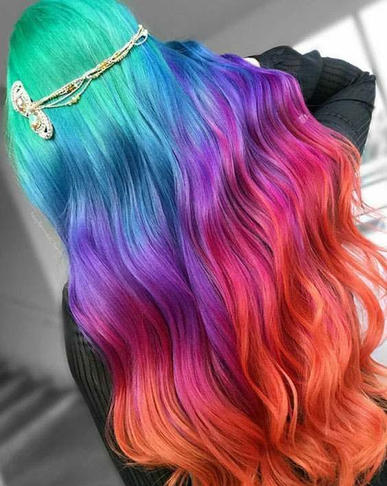 super long hair with waves dyed in rainbow colors will turn you into a fairy