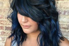 07 a black medium layered and shaggy haircut with dark blue balayage that brings even more dimension