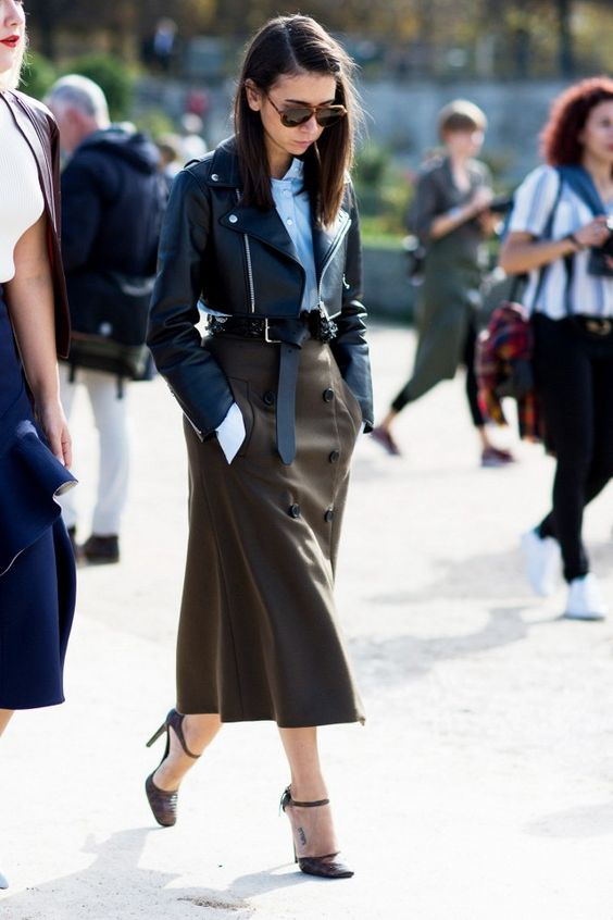 a blue shirt, a cropped black leather jacket, a brown button down midi and brown shoes