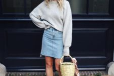07 a grey oversized sweatshirt, a blue denim skirt, brown shoes and a basket as a bag