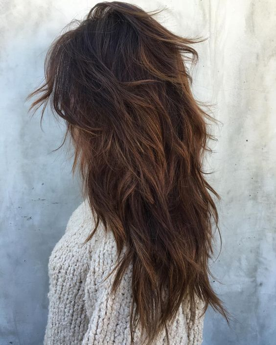 a long layered and super shaggy haircut for a wild and boho inspired look