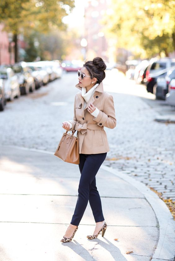 navy pants, a white sweater, leopard print shoes and a tan short trench for a fall work look