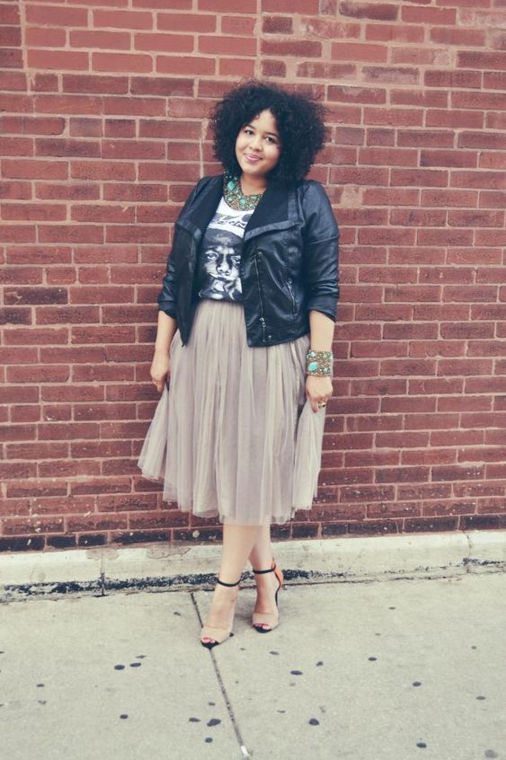 nude shoes, a grey tulle skirt, a printed tee, a black leather jacket and statement accessories